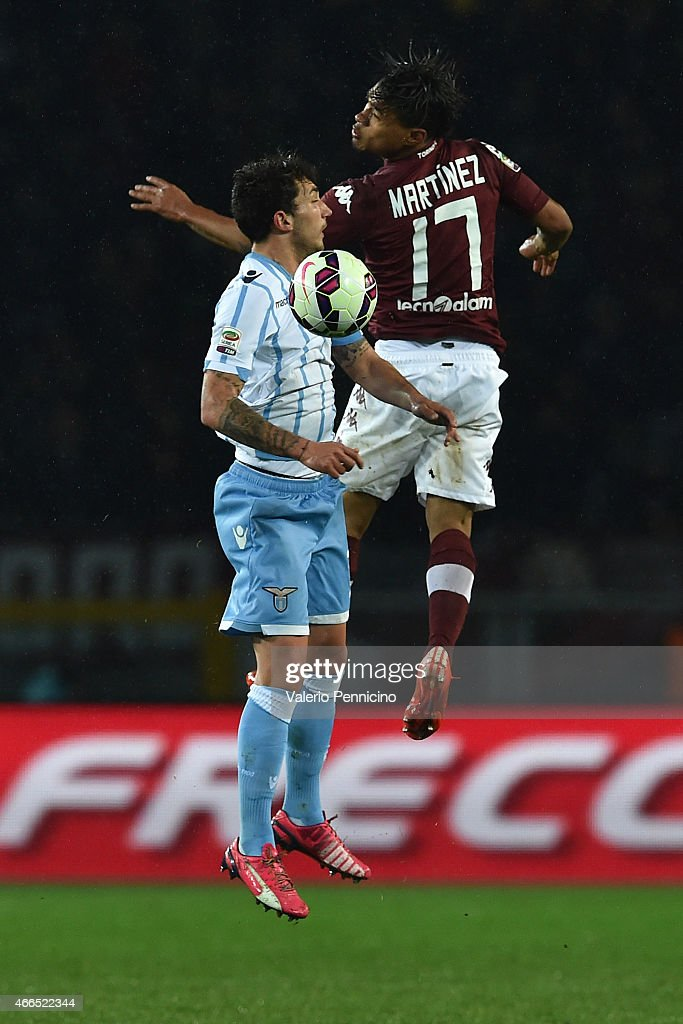 Josef Alexander Martinez (R) of Torino FC goes up with Danilo Cataldi of SS Lazio during the Serie A match between Torino FC and SS Lazio at Stadio Olimpico di Torino on March 16, 2015 in Turin, Italy.