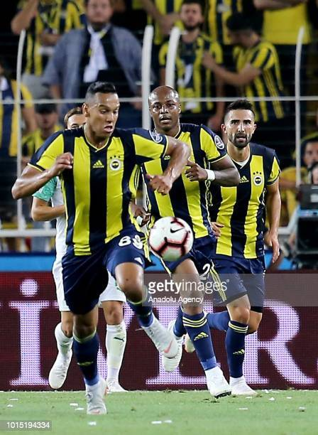 Josef De Souza Andre Ayew and Hasan Ali Kaldirim of Fenerbahce in action during Turkish Super Lig match between Fenerbahce and Bursaspor at Ulker...