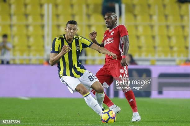 Josef De Souza Dias of Fenerbahce Thievy Bifouma of Sivasspor during the Turkish Super lig match between Fenerbahce v Sivasspor at the Sukru...