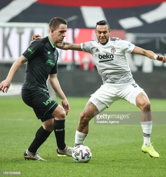 Josef De Souza of Besiktas in action against Amir Hadziahmetovic of Ittifak Holding Konyaspor during Turkish Super Lig match between Besiktas and...