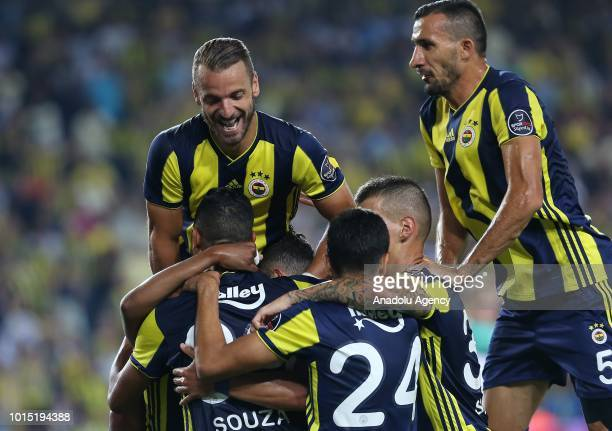 Josef De Souza of Fenerbahce celebrates with his teammates after scoring a goal during Turkish Super Lig match between Fenerbahce and Bursaspor at...