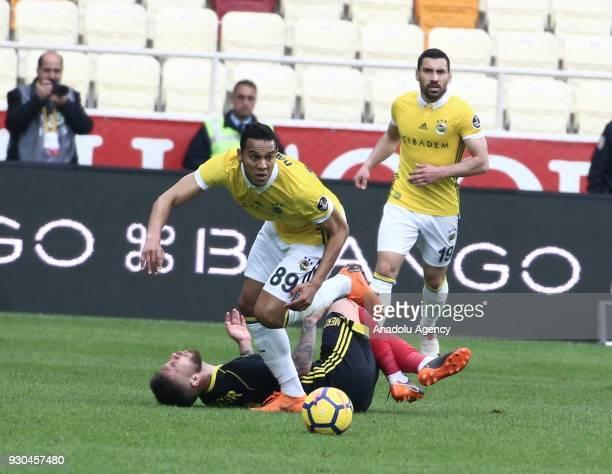 Josef De Souza of Fenerbahce in action against Adem Buyuk of Evkur Yeni Malatyaspor during the Turkish Super Lig soccer match between Evkur Yeni...
