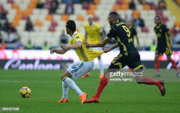 Josef De Souza of Fenerbahce in action against Boutaib of Evkur Yeni Malatyaspor during the Turkish Super Lig soccer match between Evkur Yeni...