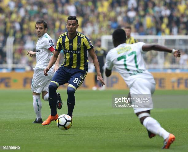 Josef De Souza of Fenerbahce in action against Emmanuel Badu of Bursaspor during Turkish Super Lig soccer match between Fenerbahce and Bursaspor at...