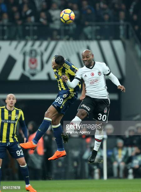 Josef De Souza of Fenerbahce in action against Vagner Love of Besiktas during a Turkish Super Lig soccer match between Besiktas and Fenerbahce at...