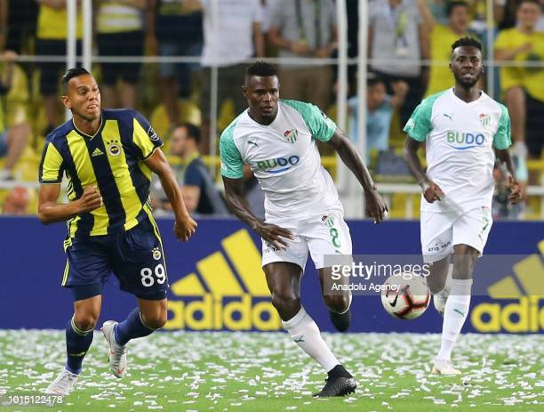 Josef De Souza of Fenerbahce vies with Stephane Badji of Bursaspor during Turkish Super Lig match between Fenerbahce and Bursaspor at Ulker Stadium...
