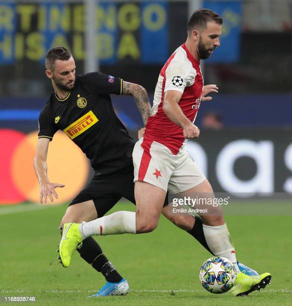 Josef Husbauer of SK Slavia Praha is challenged by Marcelo Brozovic of FC Internazionale during the UEFA Champions League group F match between FC...