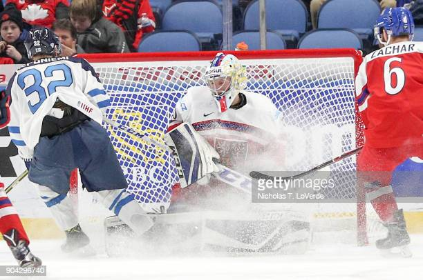 Josef Korenar of Czech Republic defends his net against Aleksi Heponiemi of Finland during the third period of play in the IIHF World Junior...
