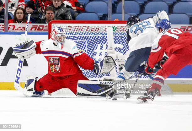 Josef Korenar of Czech Republic makes a save against Aleksi Heponiemi of Finland during the first period of play in the IIHF World Junior...