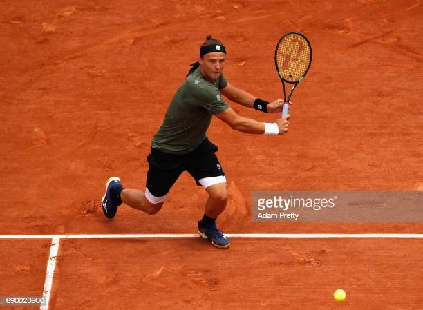 Josef Kovalik of Slovakia plays a backhand during the mens singles first round match against Stan Wawrinka of Switzerland on day three of the 2017...