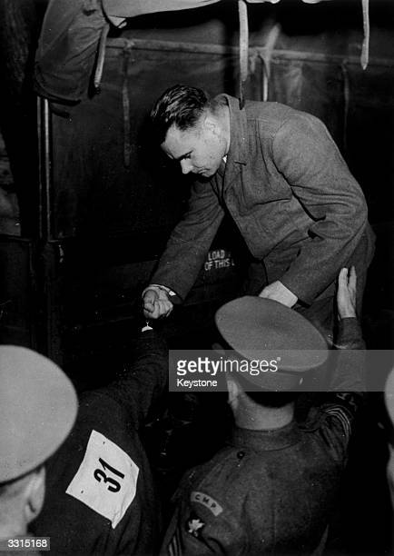 Josef Kramer, commander of the Belsen concentration camp, being assisted down from a truck as he arrived at court for trial. He was executed in...