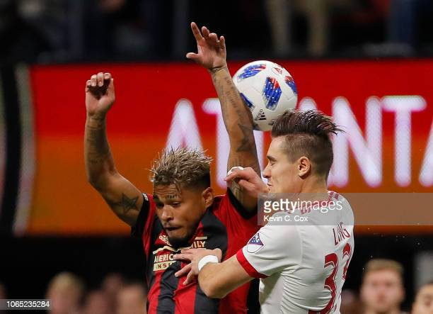 Josef Martinez of Atlanta United competes for a header against Aaron Long of New York Red Bulls during the MLS Eastern Conference Finals between...