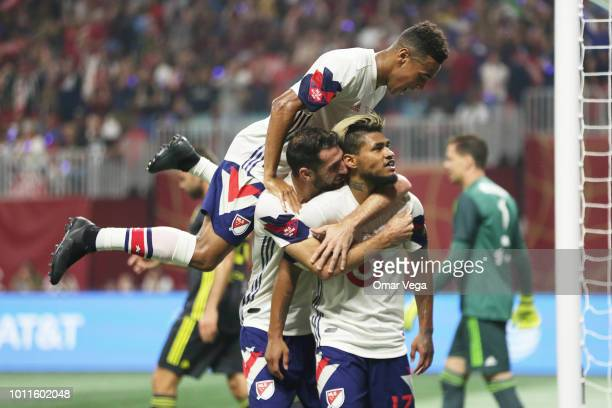 Josef Martinez of MLS AllStars celebrates with teammates after scoring the equalizer during a match between Juventus and MLS AllStars at MercedesBenz...