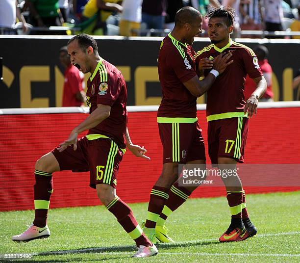 Josef Martinez of Venezuela celebrates with teammates after scoring the opening goal during a group C match between Jamaica and Venezuela at Soldier...