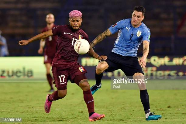Josef Martínez of Venezuela fights for the ball with José Giménez of Uruguay during a match between Venezuela and Uruguay as part of South American...