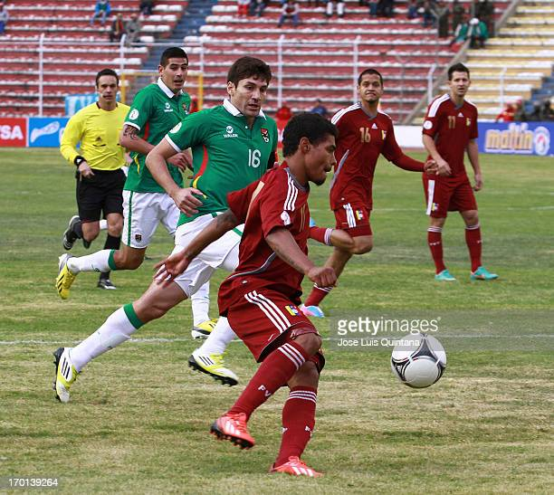 Josef Martínez of Venezuela fights for the ball with Ronald Raldez of Bolivia during a match between Bolivia and Venezuela as part of the 13th round...