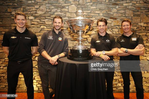 Josef Newgarden, Alexander Rossi, Simon Pagenaud and Scott Dixon pose for a photo with the Astor Cup following a press conference at Wave Street...