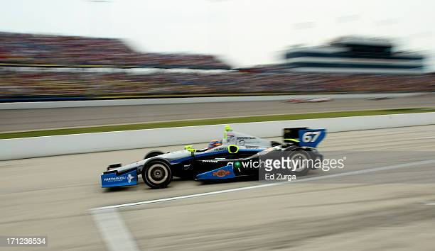 Josef Newgarden driver of the Sarah Fisher Hartman Racing Honda exits the pits during the Iowa Corn Indy 250 at Iowa Speedway on June 23 2013 in...