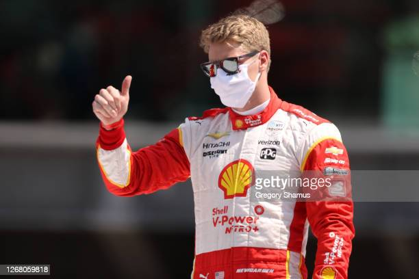 Josef Newgarden, driver of the Shell V-Power Nitro Team Penske Chevrolet, stands on the grid prior to the 104th running of the Indianapolis 500 at...