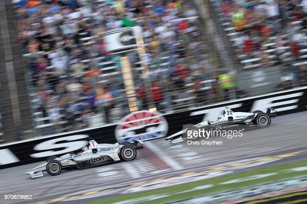 Josef Newgarden, driver of the Verizon Team Penske Chevrolet, leads Simon Pagenaud, driver of the DXC Technology Team Penske Chevrolet, at the start...
