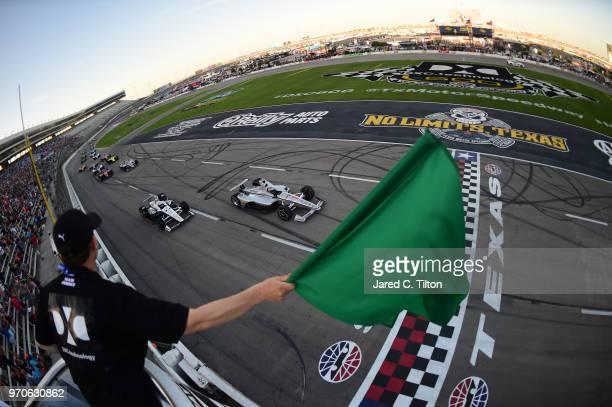 Josef Newgarden driver of the Verizon Team Penske Chevrolet leads Simon Pagenaud driver of the DXC Technology Team Penske Chevrolet at the start of...
