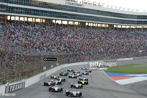 Josef Newgarden driver of the Verizon Team Penske Chevrolet leads Simon Pagenaud driver of the DXC Technology Team Penske Chevrolet at the start of...