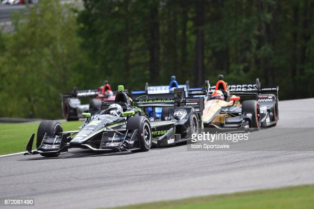 Josef Newgarden just ahead of James Hinchcliffe during the Honda Grand Prix of Alabama IndyCar race at Barber Motorsports Park in Birmingham, AL.