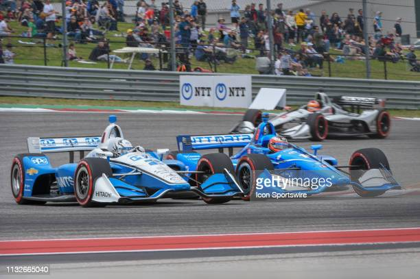 Josef Newgarden of Team Penske driving a Chevy and Felix Rosenqvist of Chip Ganassi Racing driving a Honda race wheel to wheel as they accelerate...