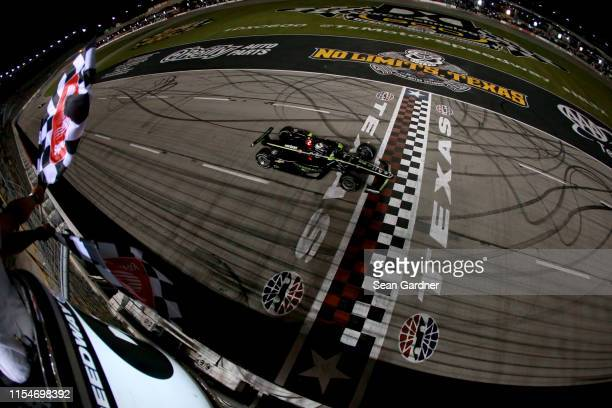 Josef Newgarden of the United States, driver of the Fitzgerald USA Team Penske Chevrolet, takes the checkered flag to win the NTT IndyCar Series DXC...