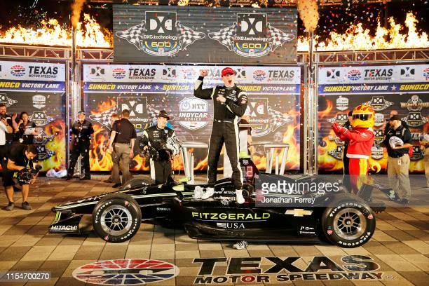 Josef Newgarden of the United States, driver of the Fitzgerald USA Team Penske Chevrolet, celebrates in victory lane after winning the NTT IndyCar...