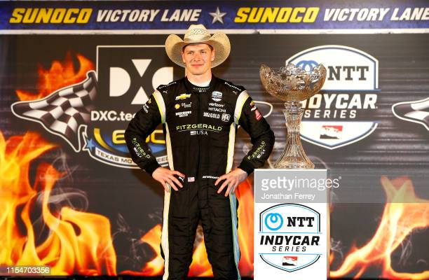 Josef Newgarden of the United States, driver of the Fitzgerald USA Team Penske Chevrolet, poses with the trophy after winning the NTT IndyCar Series...