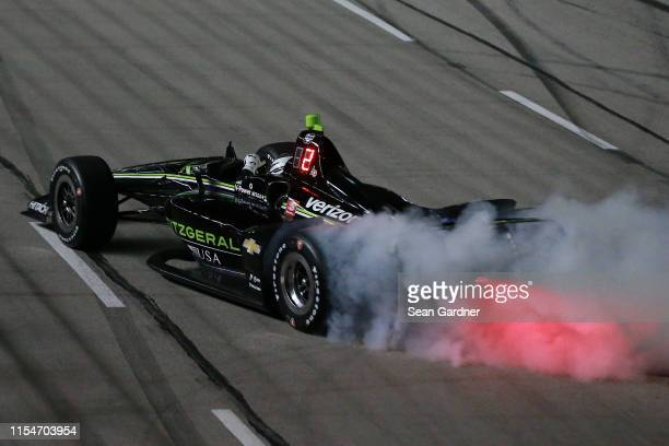 Josef Newgarden of the United States, driver of the Fitzgerald USA Team Penske Chevrolet, celebrates with a burnout after winning the NTT IndyCar...