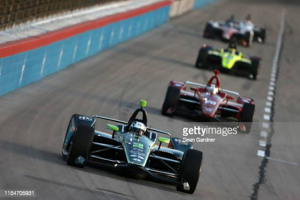 Josef Newgarden of the United States, driver of the Fitzgerald USA Team Penske Chevrolet, leads a pack of cars during the NTT IndyCar Series DXC...