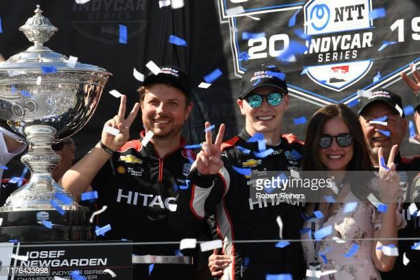 Josef Newgarden of United States and Hitachi Team Penske Chevrolet celebrates winning the NTT IndyCar Series championship following the Firestone...