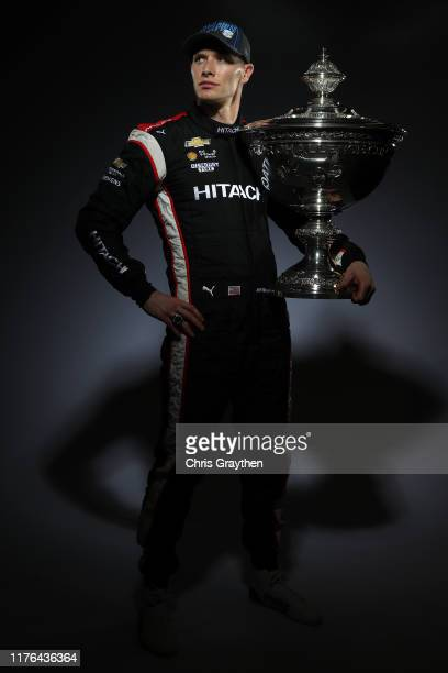 Josef Newgarden of United States and Hitachi Team Penske Chevrolet poses for a photo with the Astor Challenge Cup after winning the season...