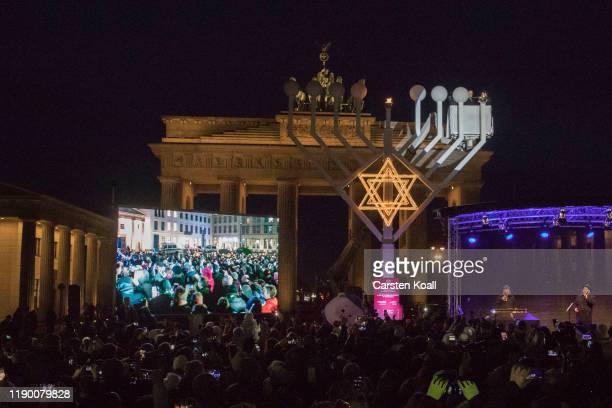 Josef Schuster President of the Central Council of Jews in Germany and Rabbi Yehuda Teichtal light the Hanukkah menorah lighting at a public Menorah...