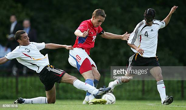 Josef Sural of Czech Rebublic Manuel Gulde of Germany and his teammate Nils Teixeira fight for the ball during the U19 match between Czech Republic...