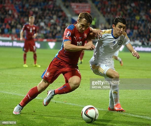 Josef Sural of Czech Republic vies for a ball with Ulan Konysbayev during the UEFA Euro 2016 qualifying round football match Kazakhztan vs Czech...