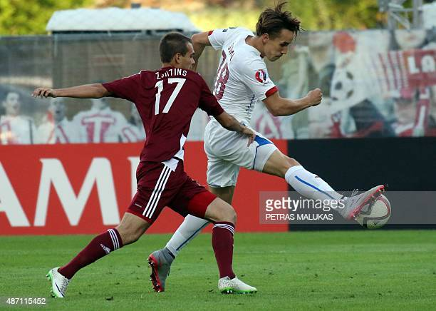 Josef Sural of Czech Republic vies with Arturs Zjuzins of Latvia during the Euro 2016 qualifying football match between Latvia and Czech Republic in...