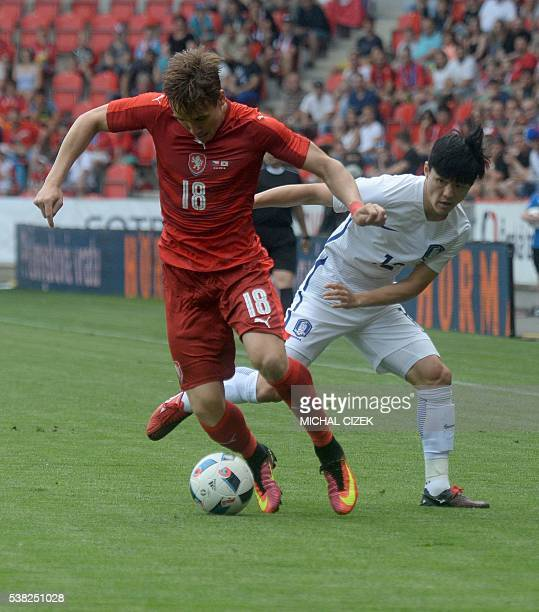 Josef Sural of Czech Republic vies with Ju Sejong of South Korea during their friendly football match on June 5 2016 in Prague ahead of the Euro 2016...