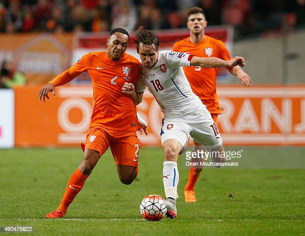 Josef Sural of the Czech Republic and Kenny Tete of the Netherlands battle for the ball during the UEFA EURO 2016 qualifying Group A match between...