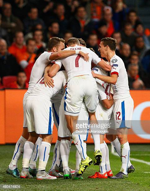 Josef Sural of the Czech Republic is mobbed by team mates in celebration as he scores their second goal during the UEFA EURO 2016 qualifying Group A...