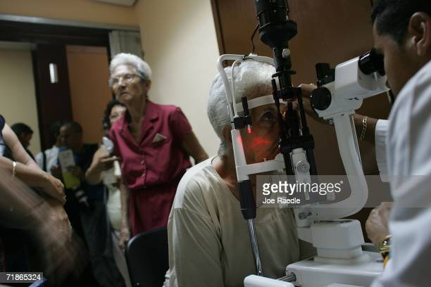 Josefa Martinena Perez has her eyes checked by Dr Omar Diaz Arncibia as she takes advantage of 'Operacion Milagro' September 12 2006 at Pando Ferrer...