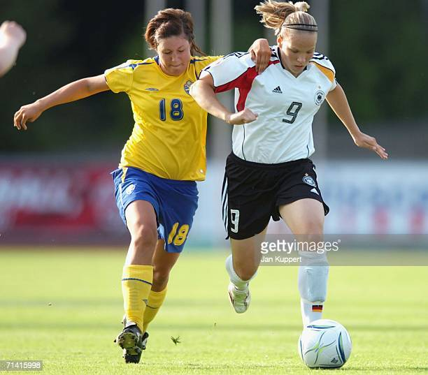 Josefin Johannsson of Sweden vies for the ball with Isabel Kerschowski of Germany during the Women's U19 European Championship Final Round between...
