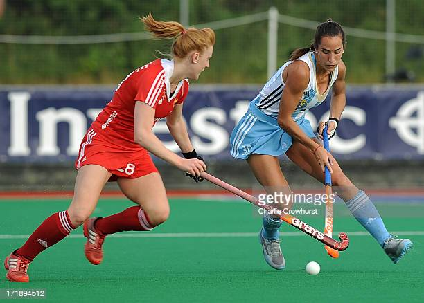 Josefina Maria Sruoga of Argentina looks to get past Nicola White of England during the Investec Hockey World League Semi Finals match between...