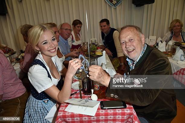 Josefina Vilsmaier and her father Joseph Vilsmaier attend the BMW Armbrustschiessen at Armbrust-Schuetzenfesthalle during the Oktoberfest 2015 at...