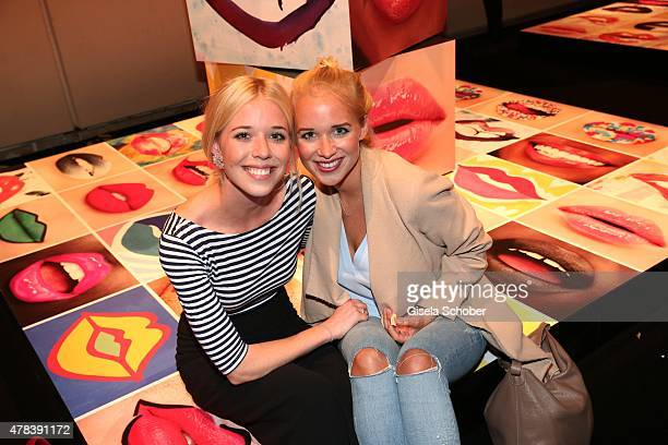 Josefina Vilsmaier and her sister Theresa Vilsmaier during the presentation of 'Art of the Lip' by MAC Cosmetics at Haus der Kunst on June 24, 2015...