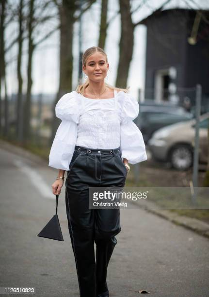 Josefine Haaning Jensen is seen wearing white blouse with wide sleeves black pants YSL bag outside Munthe during the Copenhagen Fashion Week...