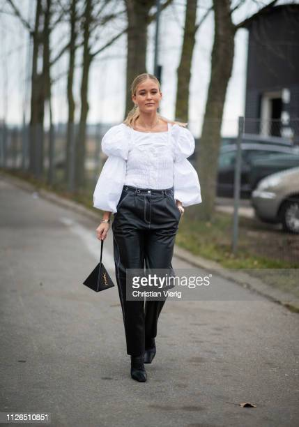 Josefine Haaning Jensen is seen wearing white blouse with wide sleeves, black pants, YSL bag outside Munthe during the Copenhagen Fashion Week...