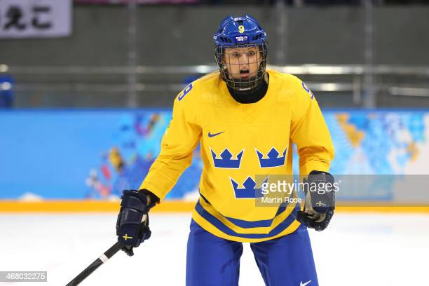 Josefine Holmgren of Sweden looks on during the Women's Ice Hockey Preliminary Round Group B Game on day two of the Sochi 2014 Winter Olympics at...